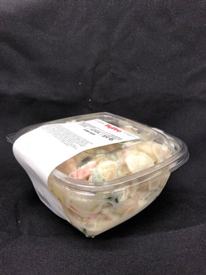 pasta salad in a clam shell side view
